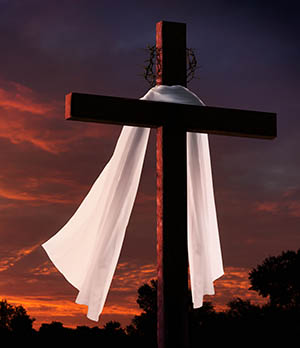 Dramatic Lighting on Christian Easter Cross at Sunrise